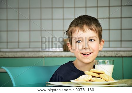 Smiling Cheerful Little Boy Sitting At The Dinner Table.  Horizontal