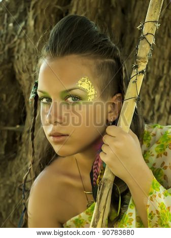 Amazon Girl With Creative Body-art And Face-art With Spear