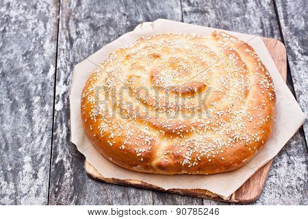 Homemade White Spiral Bread With Cheese On The Old Table