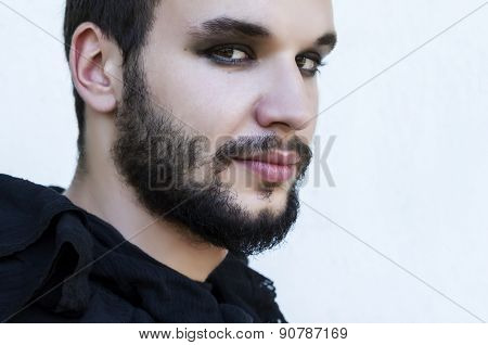 Portrait Of A Male Model With Smokey Eyes And Black Clothes