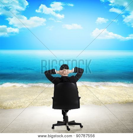 Business Man Relaxing On The Beach