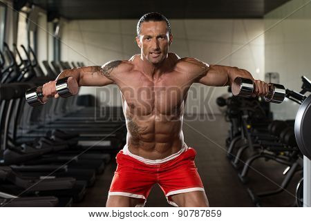 Mature Man Working Out Shoulders
