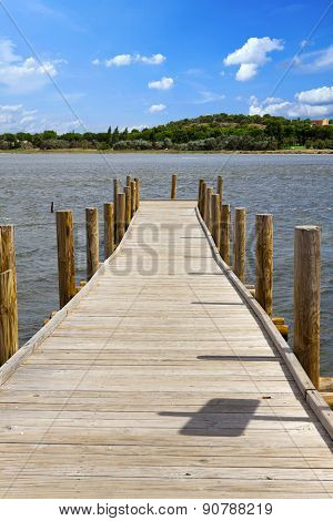 Wooden Walkway At A Lake