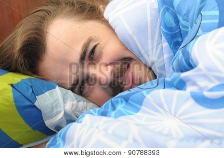 Man Rooled In Blanket Joking