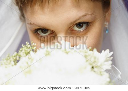 Eyes Of Bride And Bridal Bouquet