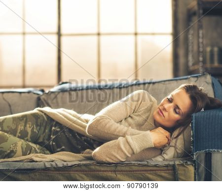 Woman Napping On A Sofa In A City Loft