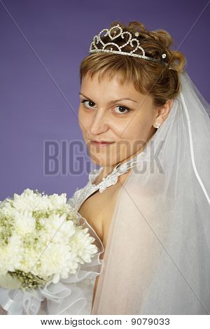 Bride With Bouquet Of White Flowers