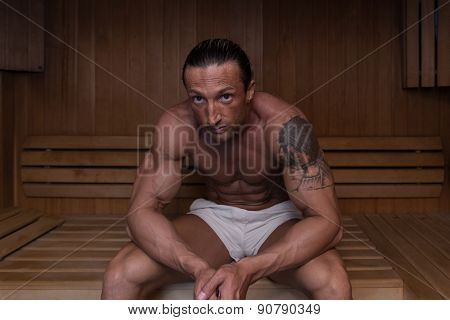 Attractive Mature Man Resting Relaxed In Sauna