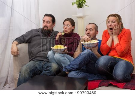 Couples Watching A Horror Movie