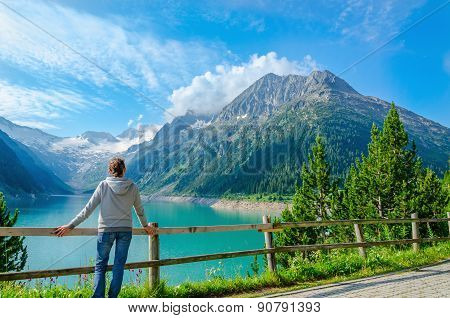 Young tourist with high peaks of Alps, Austria