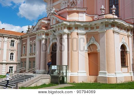 People stand at the entrance to the St. Casimir church in Vilnius, Lithuania.