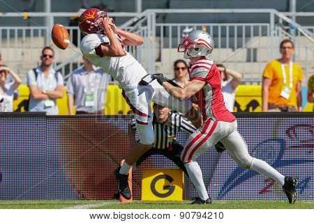 VIENNA, AUSTRIA - MAY 26, 2014: WR Tyler Stanek (#9 Claremont McKenna) fails to catch the ball.