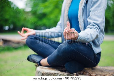 Woman In Meditation Pose Displaying Rude Gesture