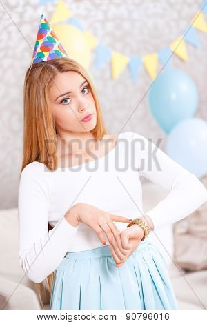 Young girl waiting for friends at birthday party