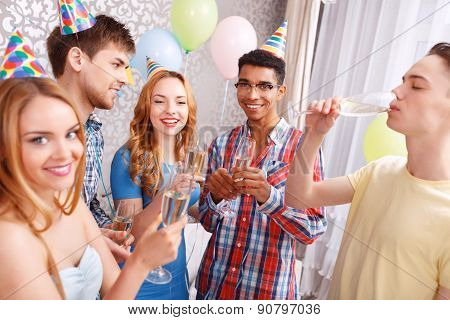 Young people celebrating with champagne