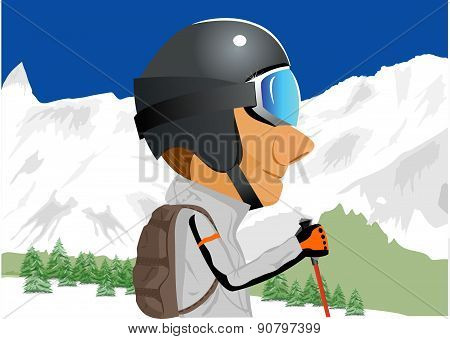 skier standing amongst snow capped mountains
