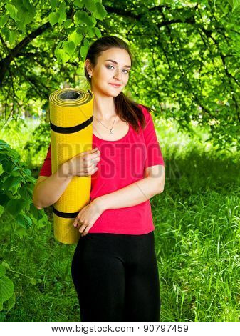 Girl Holding Yellow Sport  And Going To The Yoga Class