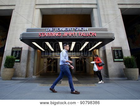 NEW YORK CITY - FRIDAY, MAY 8, 2015: Pedestrians walk past the entrance to the NBC television studio hosting The Tonight Show with Jimmy Fallon.