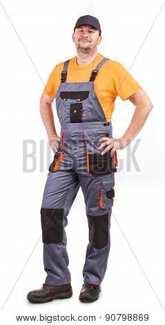 Happy worker wearing overalls.