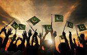 stock photo of pakistani flag  - Group of People Waving Flag of Pakistan in Back Lit - JPG