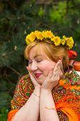 picture of flirty  - Cheeked Russian cheerful young woman in a wreath of fresh dandelion flirt flirty look - JPG