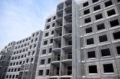 foto of reinforcing  - Unfinished building of reinforced concrete panels without windows - JPG