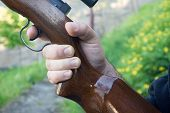 image of shotgun  - Detail of a mans hand holding shotgun - JPG