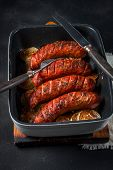 image of onion  - Sausages baked with onion rings in brytfance - JPG