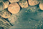 picture of bread rolls  - Different kind of freshly baked bread rolls on wooden table - JPG