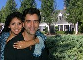 stock photo of married couple  - a married couple in front of their dream home.