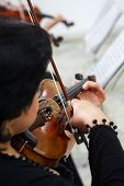 picture of violin  - Women Violinist Playing Classical Violin Music in Musical Performance - JPG