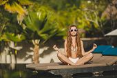 stock photo of relaxation  - Young beautiful brunette with long straight hair - JPG