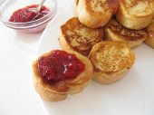 pic of french toast  - French toasts with strawberry jam on a white plate - JPG