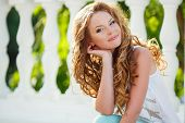 image of beautiful brunette woman  - Young beautiful woman brunette with long curly hair and gray eyes - JPG