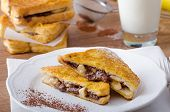 foto of french toast  - French toast stuffed with chocolate and banana fresh milk clean composition - JPG