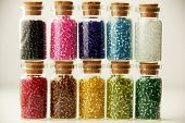 picture of beads  - Tiny glass bottles filled with beads of different colors - JPG