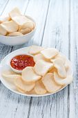foto of chinese crackers  - Fresh made Prawn Crackers (Krupuk) on wooden background