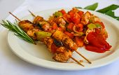 picture of braai  - Bbq with meat and vegetables served rosemary branch - JPG