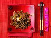 foto of stir fry  - Vietnamese beef stir fry served on a bamboo place mat - JPG