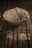 pic of loon  - Kala namak or Black salt against wooden background - JPG