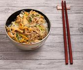 stock photo of rice noodles  - Vietnamese vermicelli chicken and rice noodles soup pho on a wood table top - JPG