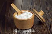 picture of salt-bowl  - Salt in wooden bowl for cooking on dark rustic table - JPG