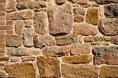 picture of fortified wall  - Old stone wall with rough texture background - JPG
