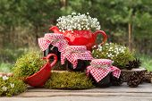 stock photo of teapot  - Red teapot tea cup and three jars of healthy jam - JPG