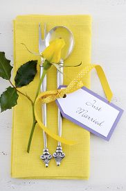 picture of yellow buds  - Yellow and white theme wedding table place setting with antique silverware napkin and yellow rose bud on white shabby chic table - JPG