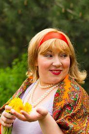 pic of cheeky  - Cheeky Russian cheerful young woman in a wreath of fresh dandelion flirt flirty look - JPG