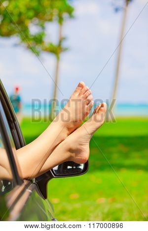 Bare Feet Of Female Sticking Out Car Window, By Ocean