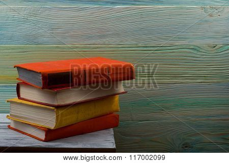 Hardback books on wooden table. Back to school. Copy space