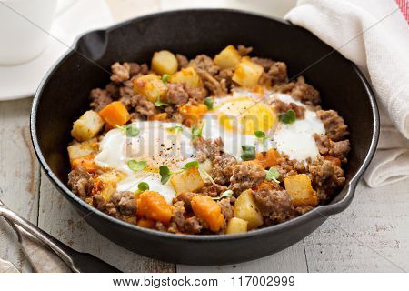 Potato hash with eggs