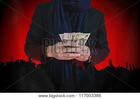 Businessman holding cash with silhouette city background, abstract concept